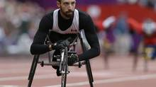 Canada's Brant Lakatos wins his men's 400m T53 race at the 2012 Paralympics, Sunday, Sept. 2, 2012, in London. (Kirsty Wigglesworth/AP)