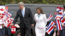 Canadian Prime Minister Stephen Harper walks with the President of Costa Rica Laura Chinchilla Miranda as he arrives at the Presidential palace in San Jose , Costa Rica, Aug. 11, 2011. (Adrian Wyld/THE CANADIAN PRESS)