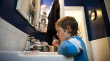 Five-year-old An'ostin Todd brushes his teeth before lunch at his home in New Westminster, B.C. (Rafal Gerszak/Rafal Gerszak for The Globe and Mail)