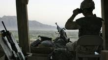 A Canadian soldier scans the horizon while on sentry duty at Ma'sum Ghar camp in Kandahar province, southern Afghanistan, on Oct. 12, 2007. (FINBARR O'REILLY/REUTERS)