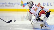 Calgary Flames goalie Miikka Kiprusoff gets ready to stop a shot by Los Angeles Kings right wing Dustin Brown during the second period of an NHL hockey game, Thursday. (Mark J. Terrill/Associated Press)