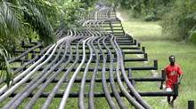 "Oil pipelines belonging to Italian oil company Agip in Obrikom, Nigeria. The IMF has urged African oil and gas producing nations to direct their oil revenues to infrastructure and education rather than on ""white elephants."" (GEORGE OSODI/ASSOCIATED PRESS)"