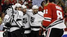 Los Angeles Kings players Jake Muzzin, Marian Gaborik, Alec Martinez and Anze Kopitar celebrate after scoring against the Chicago Blackhawks during the third period of Game 2 of the NHL Western Conference finals on Wednesday, May 21, 2014. (Nam Y. Huh/AP)