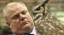 Mayor Rob Ford holds a great horned owl named Alexandra at the Toronto Sportsmen's Show at the Direct Energy Centre on Feb. 7, 2013. (J.P. Moczulski for The Globe and Mail)