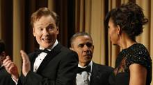 Comedian Conan O'Brien, left, looks toward First Lady Michelle Obama as U.S. President Barack Obama arrives at the White House Correspondents Association Dinner in Washington on April 27, 2013. (Kevin Lamarque/Reuters)