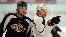 Ottawa Senators Daniel Alfredsson, right, and Chris Phillips practice at the Bell Sensplex in Ottawa on Monday, January 7, 2013. (Sean Kilpatrick/THE CANADIAN PRESS)