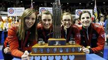 Ontario skip (L-R) Rachel Homan, Emma Miskew, Alison Kreviazuk, Lisa Weagle pose with the trophy after defeating Manitoba to win their gold medal game at the Scotties Tournament of Hearts curling championship in Kingston, February 24, 2013. (MARK BLINCH/REUTERS)
