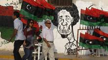 Graffiti depicting Libya leader Moammar Gadhafi adorns a wall in the rebel-held city of Banghazi. (Hassan Amar/AP)