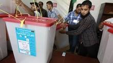 "A High Election Commission worker handles a ballot box which just arrived from the region of Kufra on Thursday, five days after Saturday's elections in Libya. ""It's a national wedding and everyone came to the party,"" Libyan-American Ali Tarhouni, 60-year-old economist and former University of Washington lecturer, said of the historic elections. (ZOHRA BENSEMRA/Reuters)"