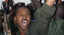 A Sudanese soldier cheers during a visit by Vice President Ali Osman Mohammed Taha in Damazin, Sudan on Sept. 17, 2011. (Abd Raouf/Associated Press/Abd Raouf/Associated Press)
