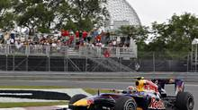 Red Bull driver Mark Webber of Australia steers his Formula One car at the hairpin turn Friday, June 11, 2010 at the Canadian Grand Prix in Montreal. (Jacques Boissinot/THE CANADIAN PRESS)