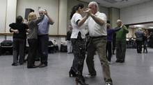 Activities like ballroom dancing that combine physical and cognitive are thought to be especially helpful. (Enrique Marcarian/REUTERS)
