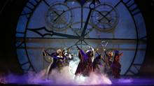 """Dancers perform in the musical """"Wicked"""" in front of the giant clockface on stage at New York's Gershwin Theatre, in this undated photo. The show opened in fall 2003. (Joan Marcus / Associated Press/AP)"""