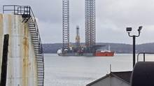 The jack-up rig Rowan Gorilla III is loaded on to the semi-submersible heavy lift ship Triumph in Halifax harbour Jan. 8, 2011. The rig was drilling on the Deep Panuke natural gas development offshore Nova Scotia. Encana Corp. has put its Deep Panuke natural gas project on hold temporarily while an investigation is carried out into why an electrical fire broke out on a production platform. (ANDREW VAUGHAN/THE CANADIAN PRESS)