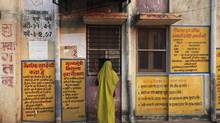 A woman stands in front of a free medicine counter at a government hospital in Shahbad village in Baran district in the northwestern state of Rajasthan January 31, 2012. (Adnan Abidi/REUTERS)