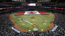 The Toronto Blue Jays take the field during the team's season opener against the Cleveland Indians at the Rogers Centre in Toronto, Ont. Tuesday, April 2/2013. (Kevin Van Paassen/The Globe and Mail)