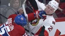 Montreal Canadiens' Francis Bouillon (55) collides with Ottawa Senators' Chris Neil during second period NHL hockey action in Montreal, Wednesday, March 13, 2013. (The Canadian Press)