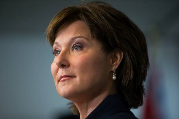 B.C. Premier Christy Clark addresses reporters in Vancouver on Tuesday, May 30.
