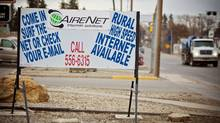 """A sign on the main street in downtown Olds, Alta., advertises """"rural high-speed"""" Internet (Chris Bolin Photography Inc. For The Globe and Mail)"""