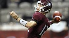 McMaster Marauders quarterback Kyle Quinlan throws a pass during the first half of their Vanier Cup college football game against Laval Rouge et Or at BC Place in Vancouver, British Columbia, November 25, 2011. (BEN NELMS/REUTERS)