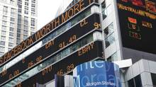 The lawsuit names Facebook, its top executives, and the major underwriters of the share issue, including lead underwriter Morgan Stanley, whose headquarters display a financial news stock ticker. (Mark Lennihan/Associated Press/Mark Lennihan/Associated Press)