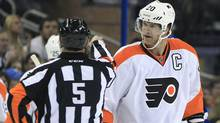 Philadelphia Flyers defenseman Chris Pronger (20) argues with referee Chris Rooney (5) after he called for a face-off as the Flyers were using their stall tactic during the first period of an NHL hockey game against the Tampa Bay Lightning, Wednesday, Nov. 9, 2011, in Tampa, Fla. (Chris O'Meara/AP)