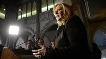 Transport Minister Lisa Raitt speaks in Ottawa on Nov. 20, 2013. (SEAN KILPATRICK/THE CANADIAN PRESS)