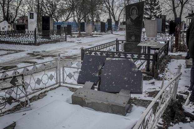 Tombstones damaged by rockets in the cemetry in Sartana.