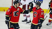 Calgary Flames' David Moss, right, celebrates his goal with teammate Olli Jokinen, from Finland, during second period pre-season NHL hockey action against the Phoenix Coyotes in Calgary, Alta., Thursday, Sept. 29, 2011. (Jeff McIntosh/THE CANADIAN PRESS)