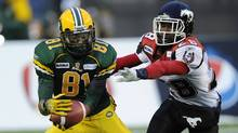 Edmonton Eskimos' Jason Barnes (L) catches a touchdown pass in front of Calgary Stampeders' Brandon Smith during the first half of their semi-final CFL football game in Calgary, Alberta, November 13, 2011. (TODD KOROL/Reuters)