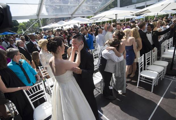 More than 100 couples took part in a mass LGBTQ wedding at Casa Loma on June 26, 2014, during World Pride 2014 in Toronto.