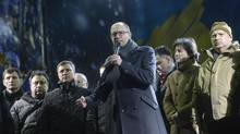 Ukrainian opposition leader Arseniy Yatsenyuk addresses anti-government protesters in Kiev, February 18, 2014. He is expected to assume the prime minister's job in a reconstructed Ukrainian government. (Andrew Kravchenko/REUTERS)