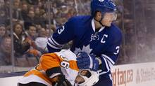 Toronto Maple Leafs Dion Phaneuf (right) tangles with Philadelphia Flyers Zac Rinaldo during third period NHL hockey action in Toronto on Monday February 11, 2013. (Chris Young/THE CANADIAN PRESS)