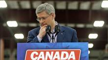 Conservative Leader Stephen Harper pauses while speaking during a campaign stop at a vehicle shop in Dieppe, N.B., on April 1, 2011. (CHRIS WATTIE/REUTERS)