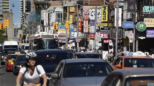 Rush hour commuters in Toronto's Chinatown.