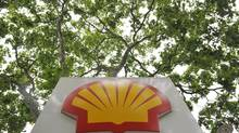 A logo is seen under a canopy of trees at a Shell petrol station in central London. (TOBY MELVILLE/REUTERS)