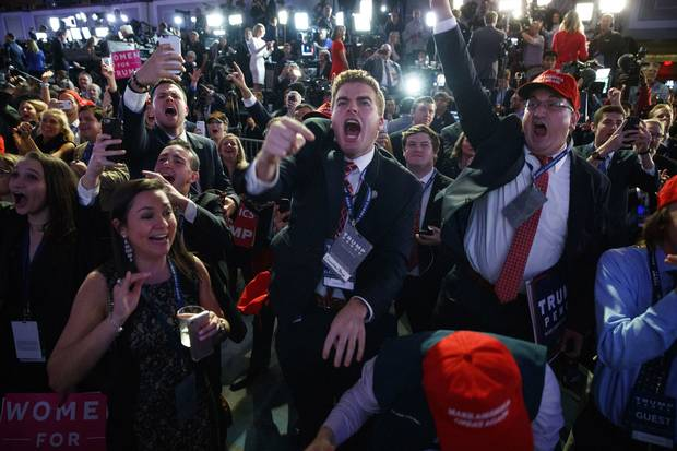 Nov. 8, 2016: Supporters of then Republican presidential candidate Donald Trump cheer as they watch election returns in New York.