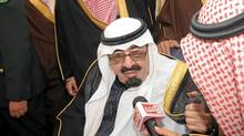 Saudi King Abdullah speaks to reporters at Riyadh airport Wednesday. He unveiled a series of benefits for Saudis on his return home on Wednesday from three months abroad for medical treatment. (Handout/Reuters/Handout/Reuters)