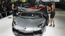 Stephan Winkelmann, president and CEO of Lamborghini, watches the unveiling of the Lamborghini LP 700-4 Aventador . (Eugene Hoshiko/Eugene Hoshiko/AP)
