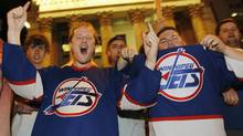 Hockey fans cheer at the corner of Portage and Main in downtown Winnipeg after media reports of the Atlanta Thrashers hockey team moving to Winnipeg, May 19, 2011. (SHAUN BEST/SHAUN BEST/Reuters)
