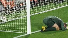 England's goalkeeper Robert Green reacts after missing a goal during their Group C first round 2010 World Cup football match on June 12, 2010 at Royal Bafokeng stadium in Rustenburg. Getty Images/ HOANG DINH NAM (HOANG DINH NAM)