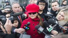 Yasmin Nakhuda leaves court after being denied custody of her famed pet monkey Darwin in Oshawa, Ontario December 21, 2012. Ms. Nakhuda was awarded visitation rights but denied them. Police were called to the Ikea store on the afternoon of December 9, 2012 in Canada's most populous city after the monkey broke loose from its cage and began running around a parking area. The monkey is currently being held at an animal sanctuary near Sunderland Ontario. It is illegal in the city of Toronto to keep exotic pets. (FRED THORNHILL/REUTERS)