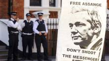 A pro-Julian Assange placard is seen outside the Embassy of Ecuador, in central London, Saturday August 18, 2012, where Wikileaks founder Julian Assange is claiming asylum in an effort to avoid extradition to Sweden. (Dominic Lipinski/AP)
