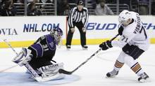 Lubomir Visnovsky of the Edmonton Oilers puts the puck past Los Angeles Kings goaltender Erik Ersberg in the 10th shootout round. (Danny Moloshok/Reuters)