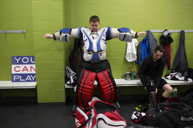 Goalie Joel Danyluk gets dressed before the game.