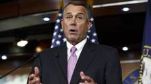 Speaker John Boehner said Tuesday the House of Representatives will vote to increase the government's borrowing cap without trying to attach conditions sought by some Republicans. (J. Scott Applewhite/Associated Press)