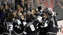 Los Angeles Kings players celebrate after defeating the New York Rangers in game five of the 2014 Stanley Cup Final at Staples Center (Richard Mackson/USA TODAY Sports)