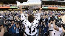 Los Angeles Kings' Justin Williams (14) holds up the Stanley Cup for the crowd before the Los Angeles Dodgers' baseball game against the Los Angeles Angels, Wednesday, June 13, 2012, in Los Angeles, Calif. (Mark J. Terrill/AP)
