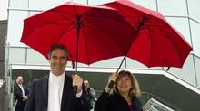 Liberal Leader Michael Ignatieff, and his wife, Zsuzsanna Zsohar, head to the bus after a round table discussion at Langara College on Tuesday, March 29, on a campaign stop in Vancouver. (Ryan Remiorz/The Canadian Press)
