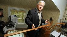 Paul Beazley , Mayor of Windsor and member of Hockey Museum Board of Directors holds a hockey stick which was hand crafted by the Mi'kmaq first nations at the hockey museum in Windsor, Nova Scotia. (Paul Darrow/The Globe and Mail/Paul Darrow/The Globe and Mail)